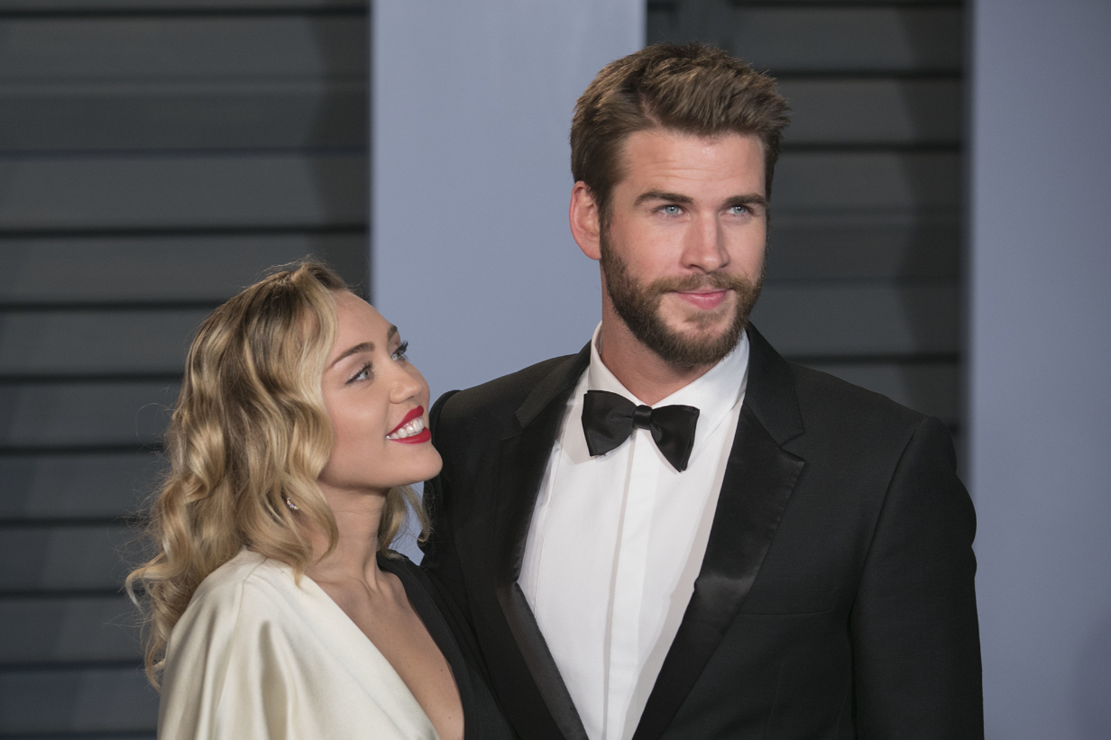 Miley Cyrus and Liam Hemsworth, pictured last year. Credit: PA